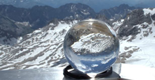 image of clear snow globe in front of alpine habitat